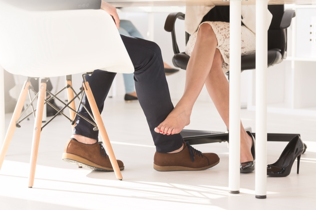 woman flirting under desk advice you should ignore over 40