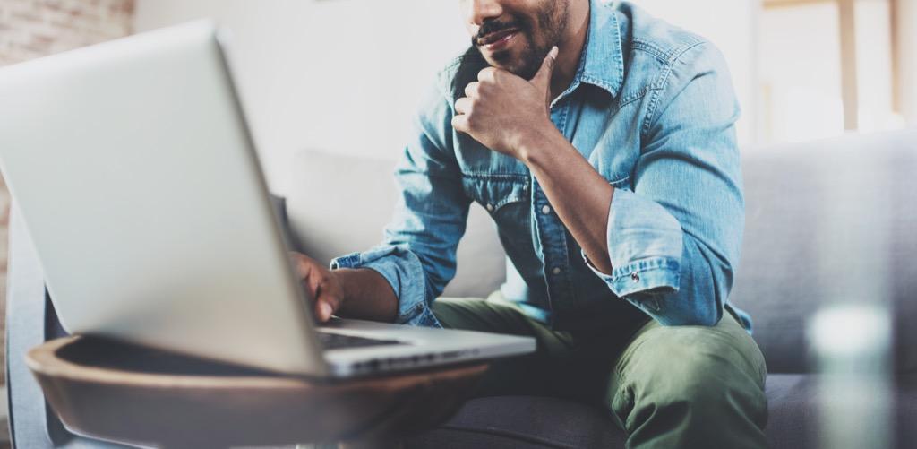man sending email, reach a customer service rep