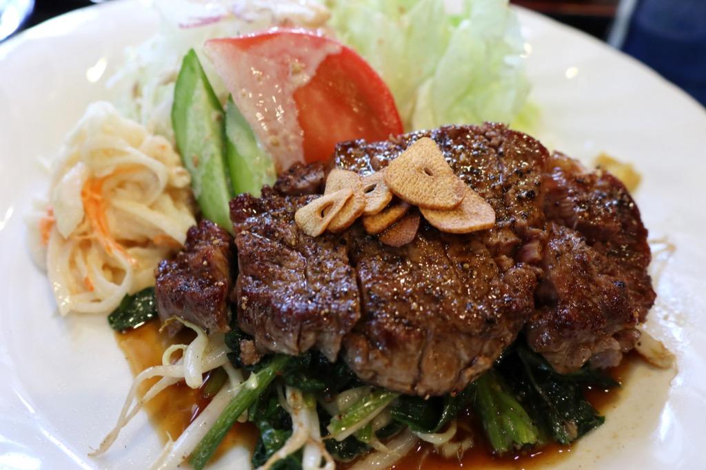 steak filet over greens