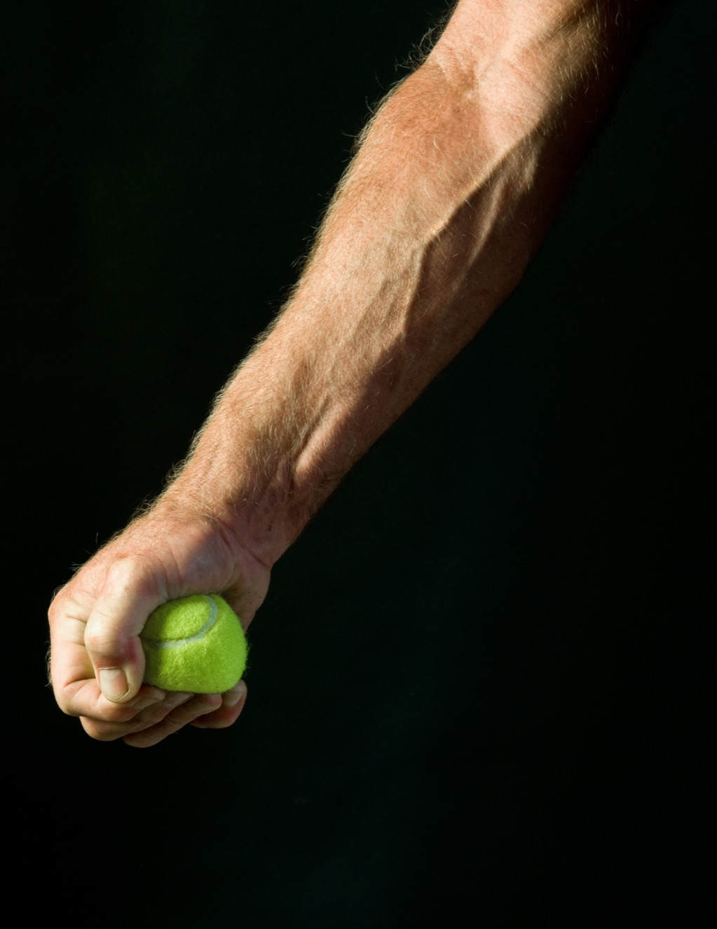 Man squeezing tennis ball for low blood pressure.
