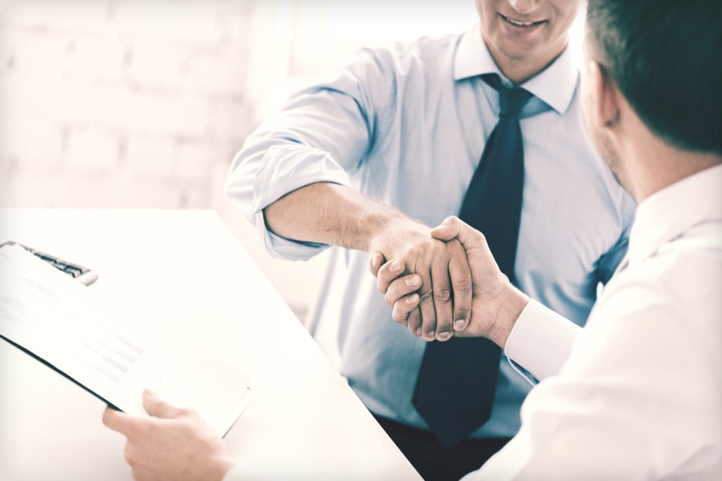Co-Founder, business partners stressed out handshake