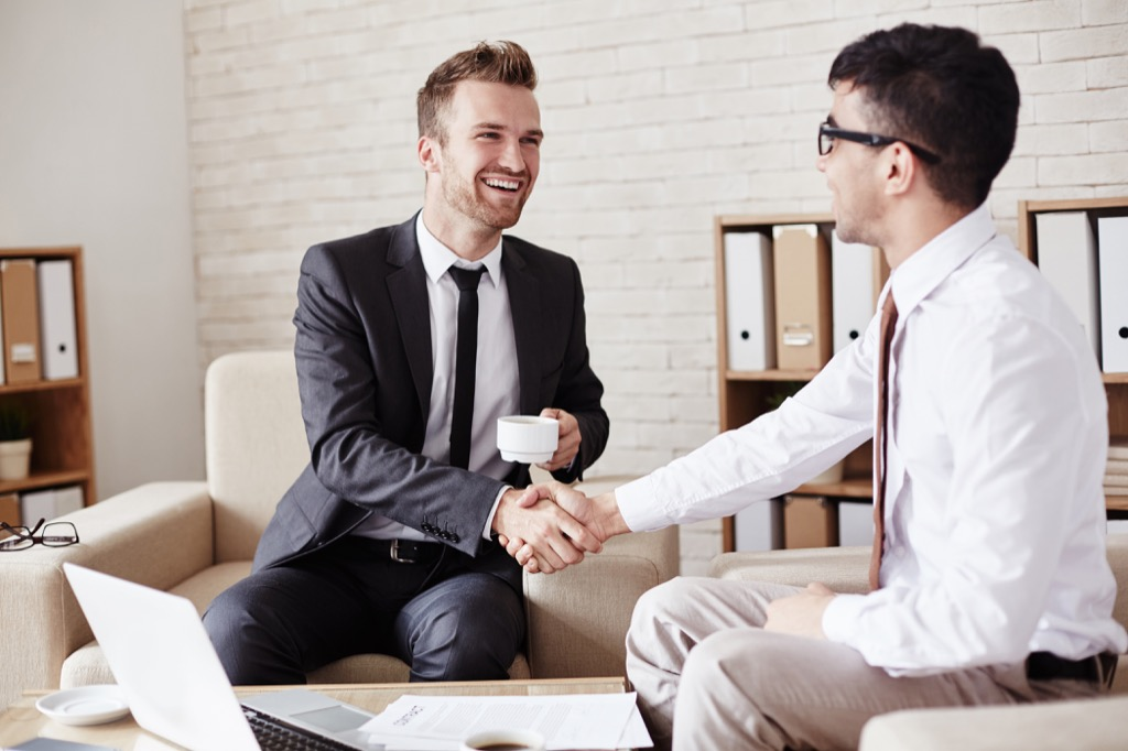 Businessman Shaking Hands Not Ready to Retire
