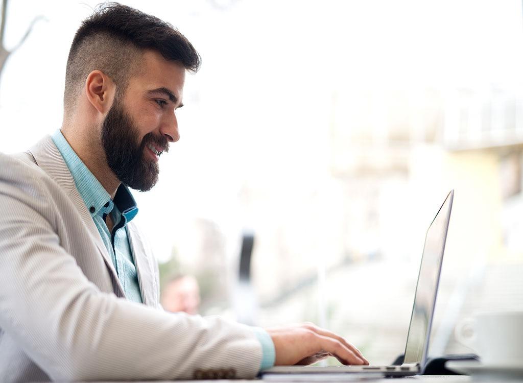 Man on Laptop 25 Years