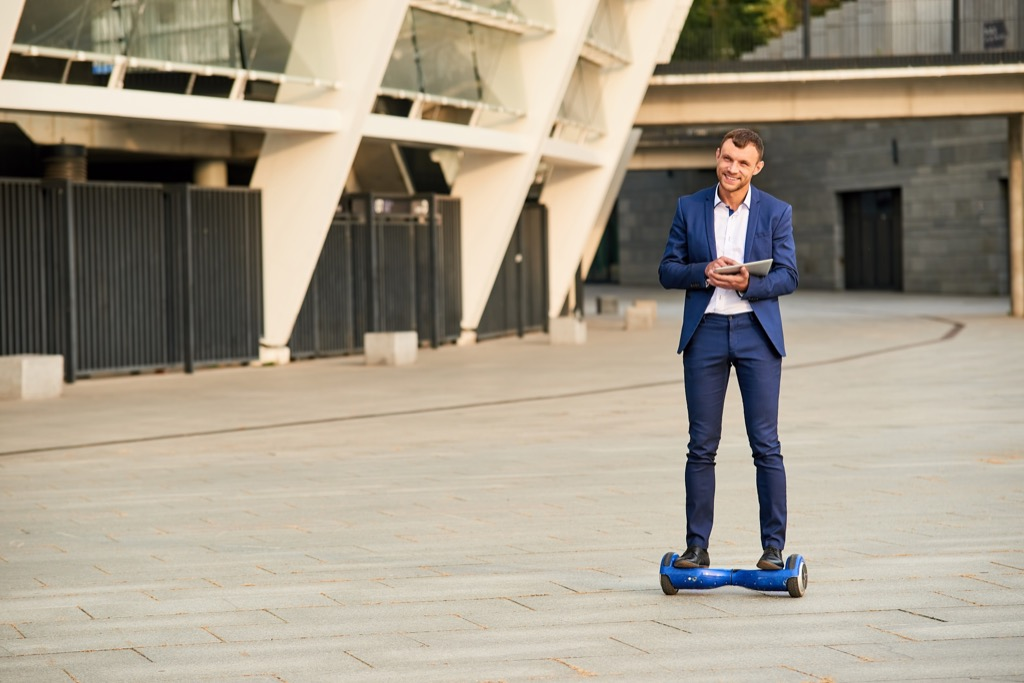 Man over 40 on a hoverboard
