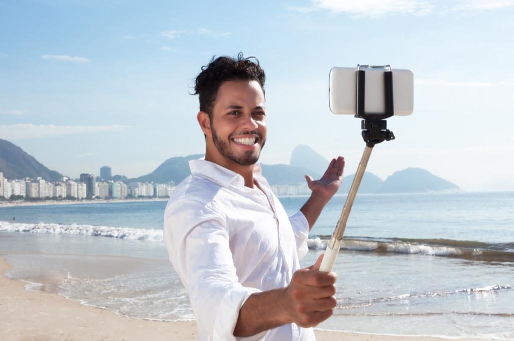 Man taking selfie on beach