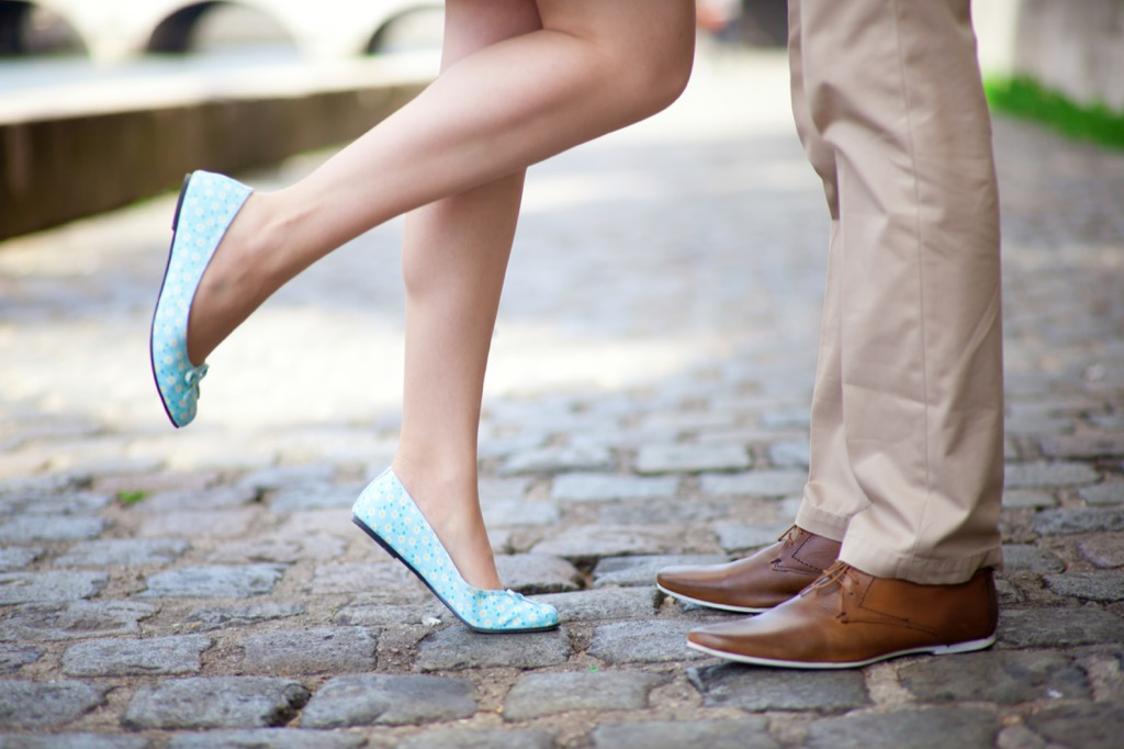 man and woman legs standing together, should i be single