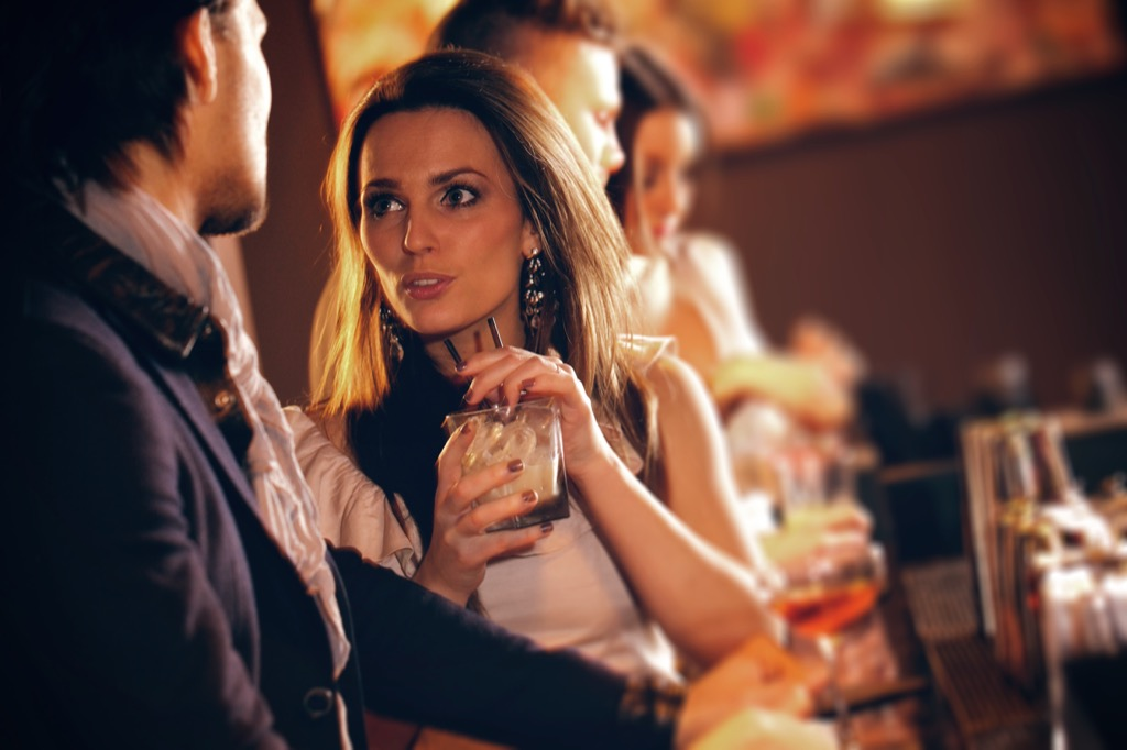 woman drinking at cocktail at the bar, should i be single