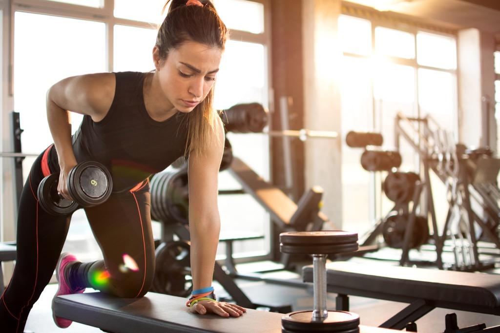 gym woman arm raise workout routine, sick