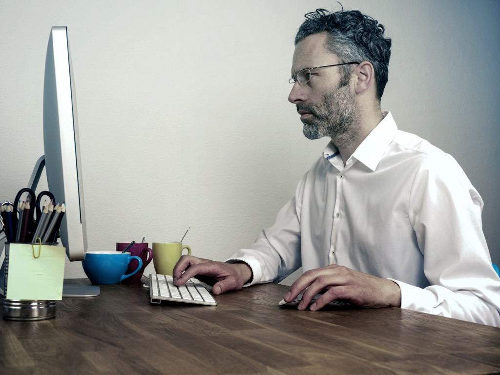 man checking in with deadlines Organized