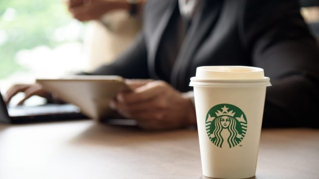 Starbucks coffee order and a man with a tablet.