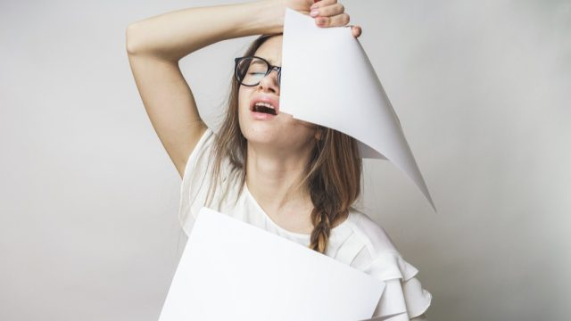 Woman having difficulty with procrastination.
