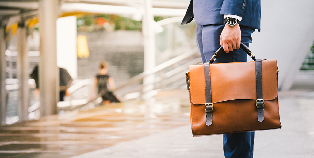 man holding a briefcase - being single