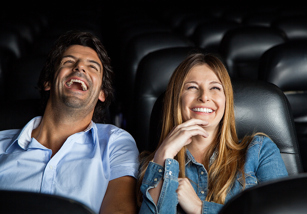 couple at a comedy show, date night ideas