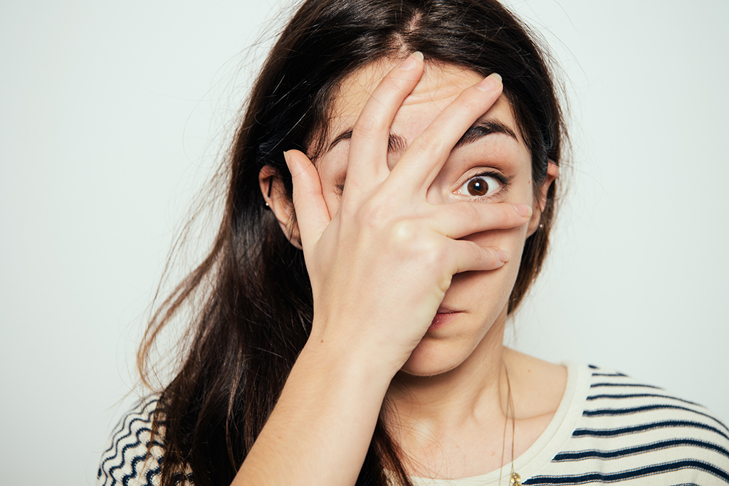 keeping secrets, embarrassed woman covering her face