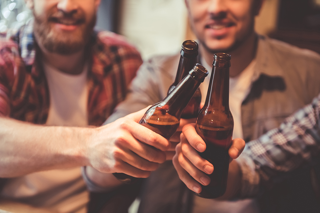 men doing a toast with beer bottles, relationship white lies