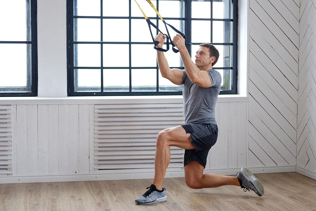 man exercising with pull-down bands
