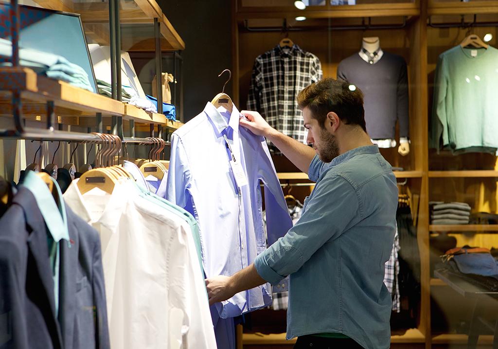 man looking at clothes, shirts, still single, shopping