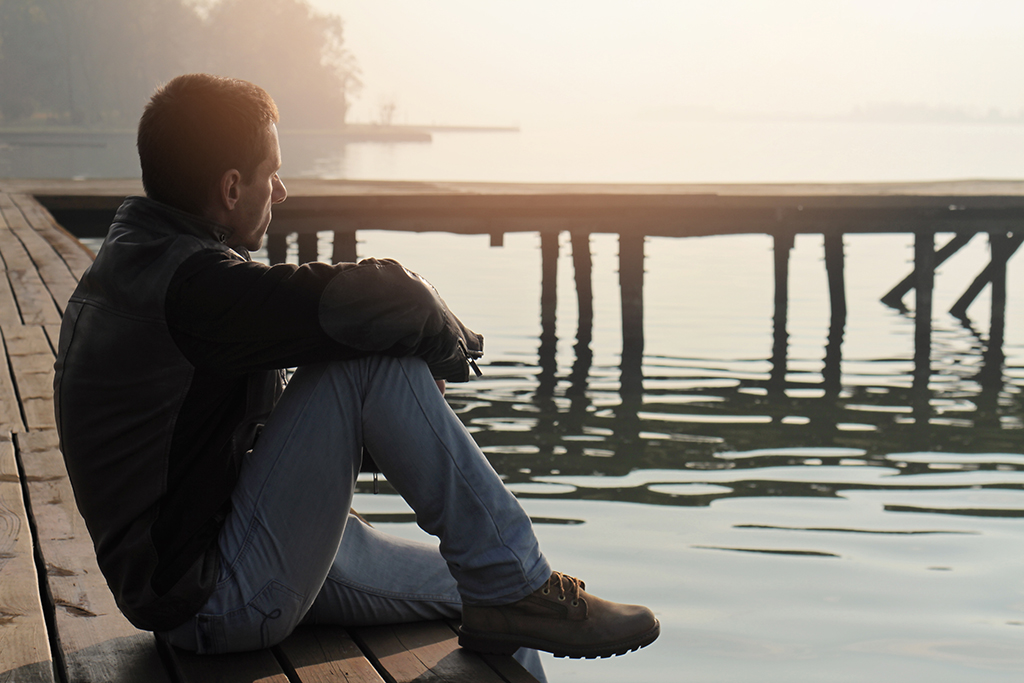 deal breaker, man alone on dock, thinking, water mother in law dating a mama's boy
