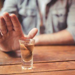 man refusing alcohol shot