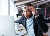 man looking at computer shocked