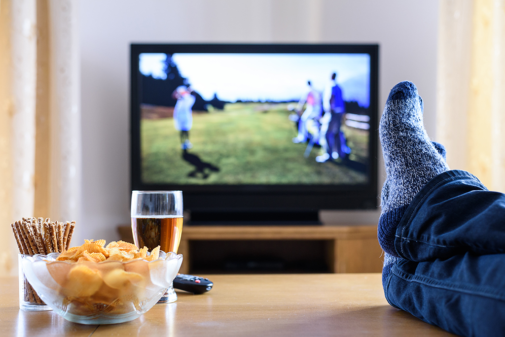 man watching tv with feet up - old wives' tales