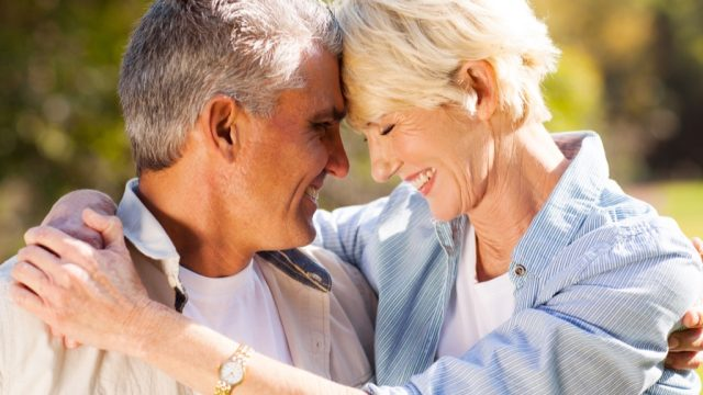 healthy older couple in embrace