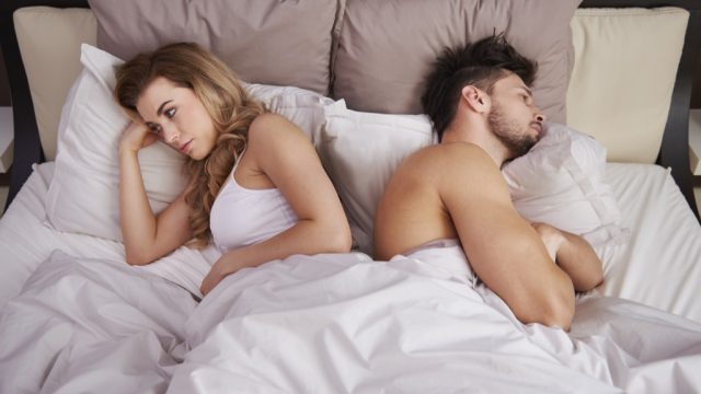 couple angry in bed