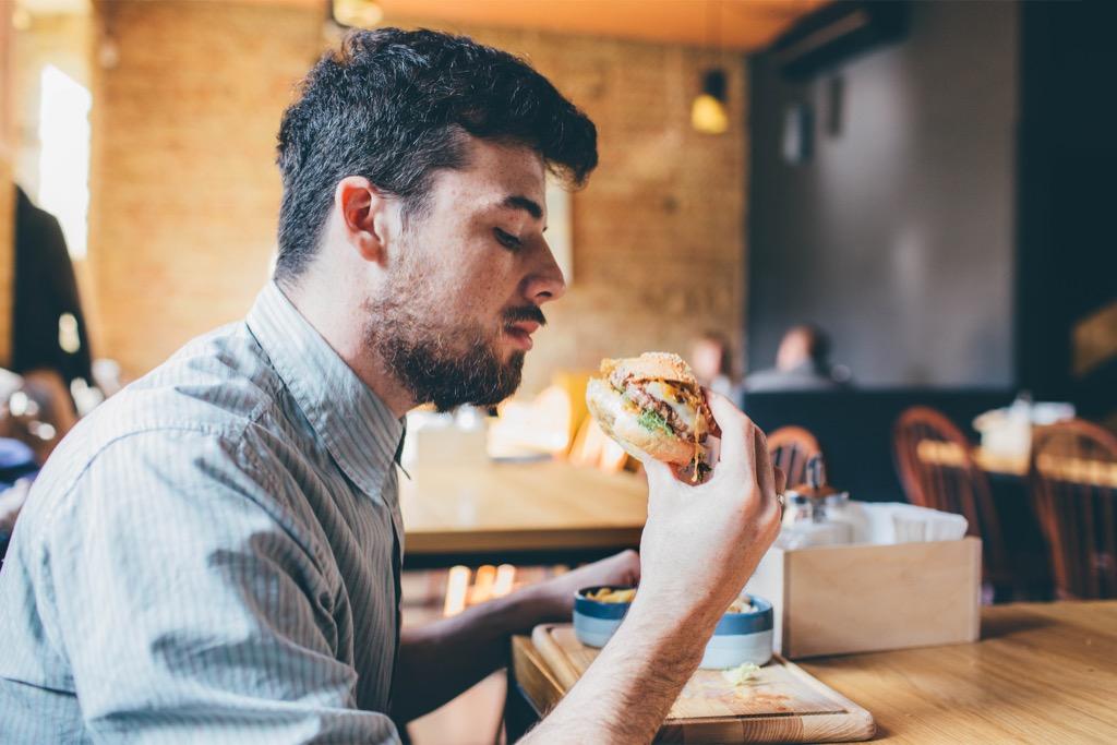 Man Eating Fast Food regrets