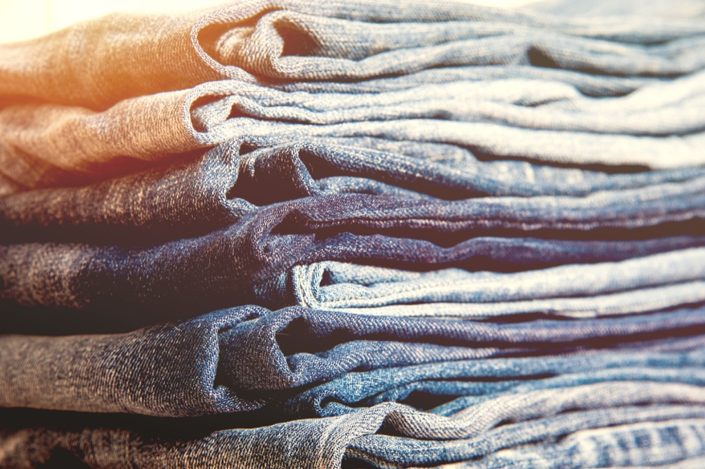 stack of blue denim jeans - how to dress over 50