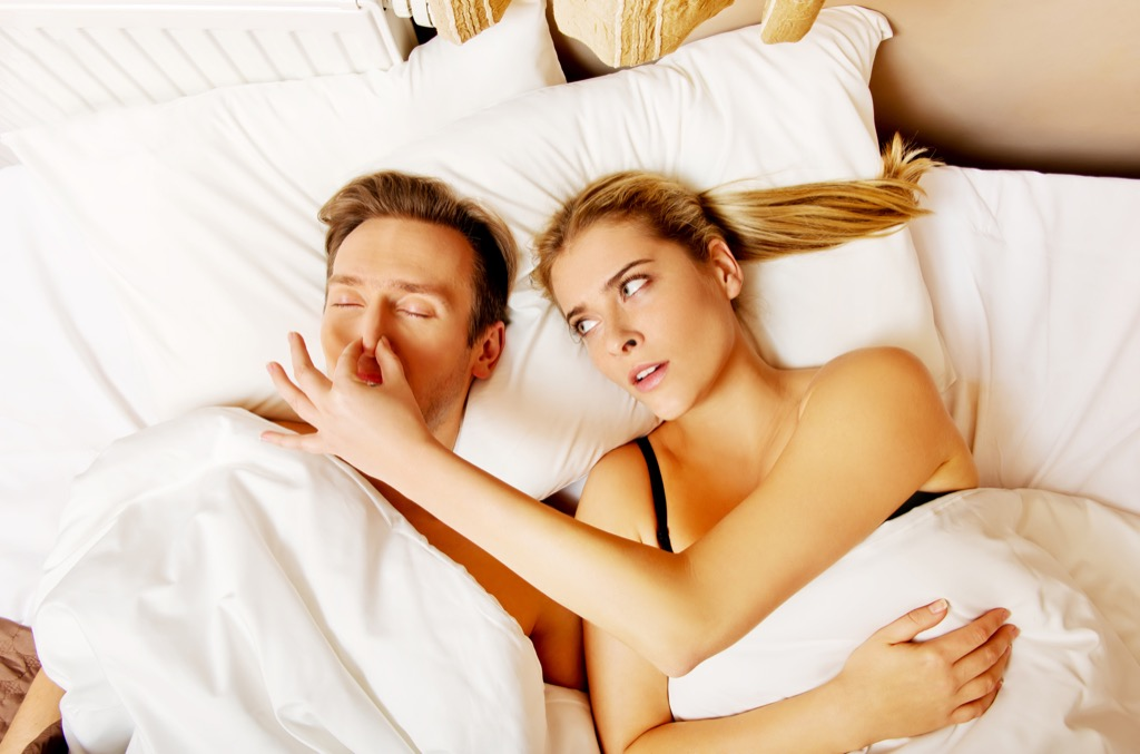 snoring nose couple in bed