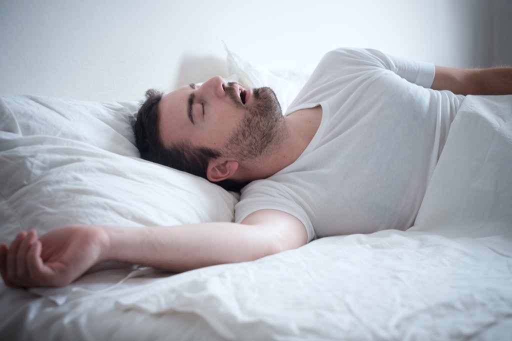man in bed lies over 40