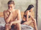 couple on bed sad erectile dysfunction having sex