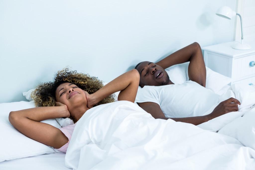 couple in bed snoring Heart Disease Risk Factors