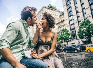 couple eating hot dog partner