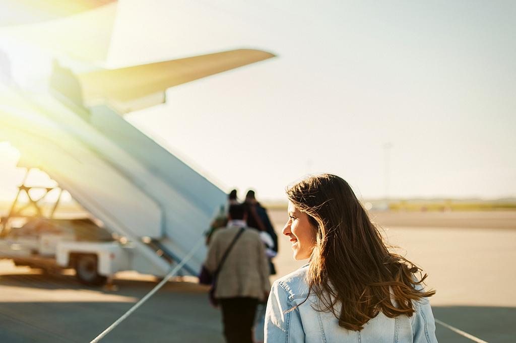 woman boarding a plane - being single