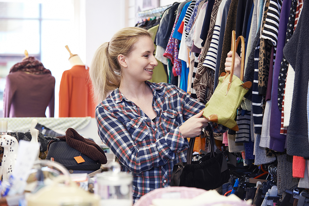 woman browsing thrift store bags shopping
