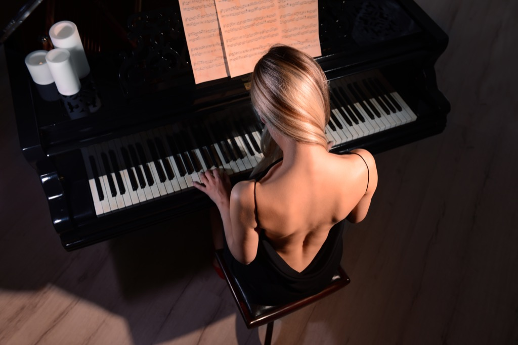 woman playing piano geniuses