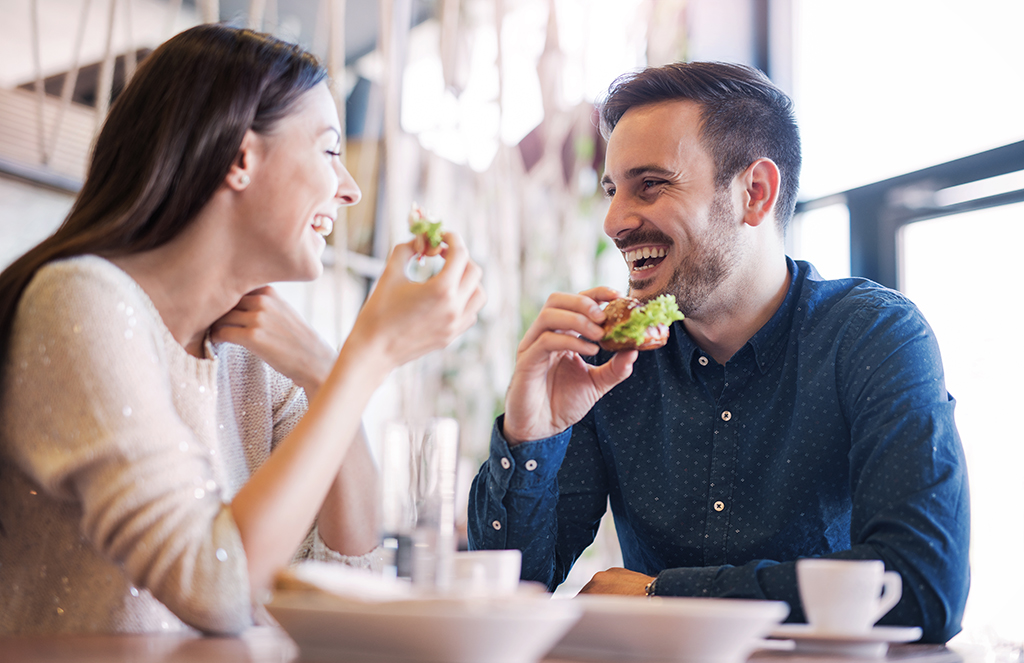 couple eating a meal together - being single