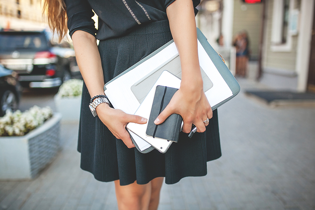 Woman with stack of papers college professor secrets