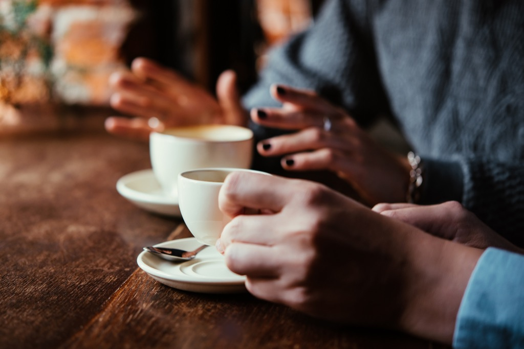 conversationalist people talking over coffee Things You Should Always Do at a Fancy Restaurant