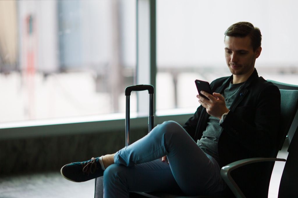 man waiting in airport punctual business travel