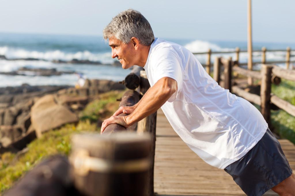 stretching on boardwalk - being single
