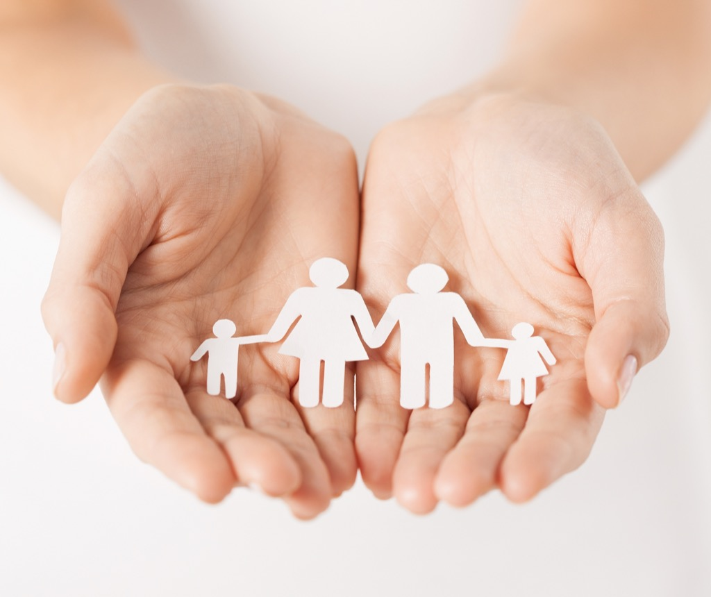 woman holding family