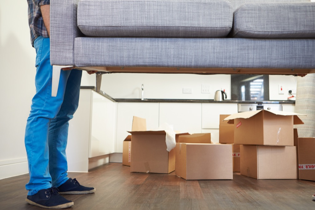 man moving couch