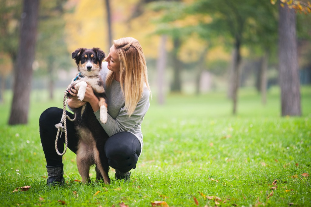 Woman with dog in park housekeeper secrets