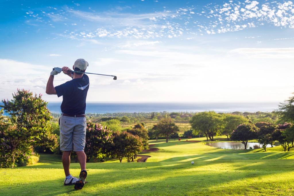 Man playing golf golfing
