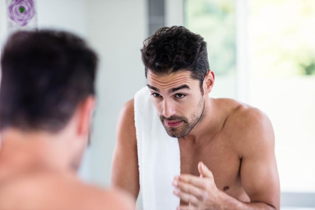 shirtless man in mirror