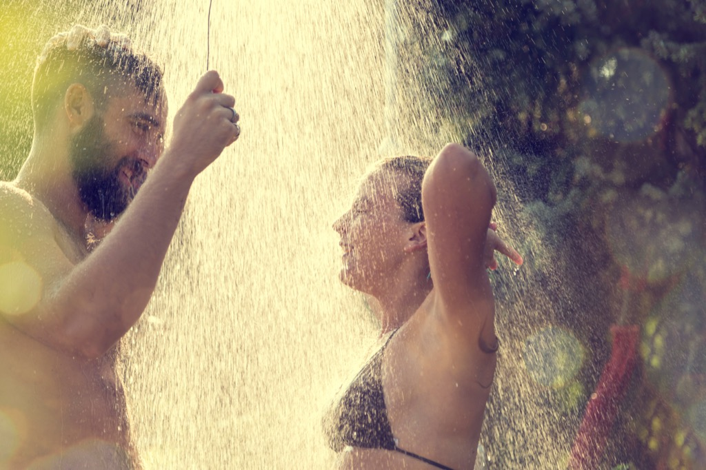 Couple having a cold shower before bed, which is great for your body clock