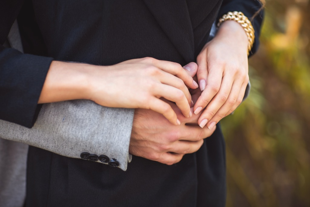 couple holding hands Body Flaws
