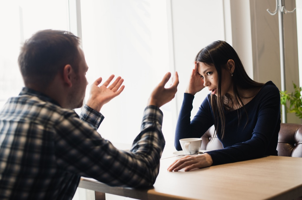 couple arguing over coffee, signs your husband is cheating